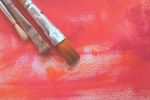 paintbrushes on red background