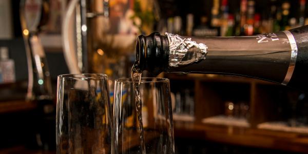 pouring prosecco into a glass